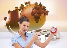 Bizneswomanu wskazujący budzik Zdjęcia Stock