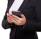 Bizneswomanu wzruszający smartphone, mienie w ona ręki obrazy stock
