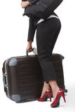 bizneswomany jej bagażu kładzenia potomstwa Zdjęcia Stock