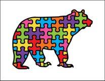Björn med autismpusselstycken arkivbilder
