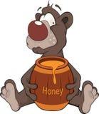 Björn och en träkeg med honung. Tecknad film Arkivfoto