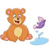 Björn och fisk Arkivbild