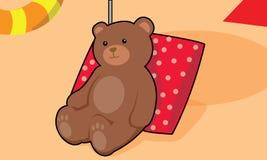 Björn på stranden Arkivbild