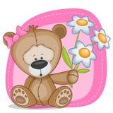 Björnflicka med blommor Arkivfoto