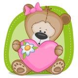 Björnflicka med hjärta Arkivbild