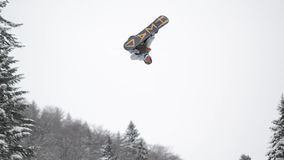 Snowboard contest. Young snowboarders jump on ski slope. Snowboard competition at mountain. Popular extreme winter sport.