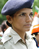 Bjp party workers in India. NEW DELHI-MAY 17: A woman Delhi police constable keeping a close eye on the BJP supporters during a rally after wining the Indian Royalty Free Stock Images