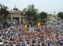 BJP rally in front of BHU . VARANASI - MAY 8: BJP supporters gathered in front of the main gate of BHU university and encircling the Madan Mohan Malaviya statue Royalty Free Stock Photo