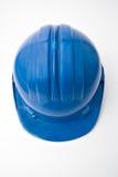 błękitny hełma bezpieczeństwa pracownicy Fotografia Royalty Free