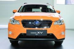BKK - NOVEMBER 28: Subaru XV 2.0i, korsar över medlet, på skärm på Arkivfoton
