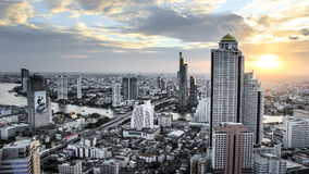 BKK river side sunset. The last light of the day though the river view in Bangkok Royalty Free Stock Photos