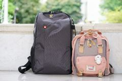 Backpacks in lovers travelling concept. royalty free stock photography
