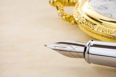Bläckpenna och watch på parchment Royaltyfria Foton