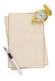 Bläckpenna och watch på parchment på white Royaltyfri Foto