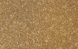 Blänka guld- bakgrund Arkivbild