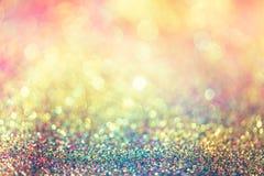 Blänka guld- bokeh Colorfull gjorde suddig abstrakt bakgrund för bir royaltyfri bild