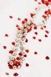 Blänka hjärtor och pärlor Royaltyfria Bilder