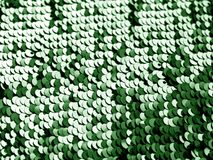 Blänka paljetttextur i grön färg arkivbild