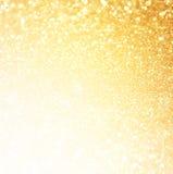 Blänka tappningljusbakgrund göra sammandrag bakgrundsguld defocused Royaltyfria Bilder