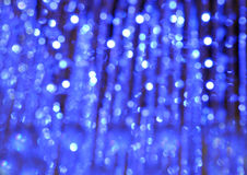 Blänka tappningljusbakgrund med ljusbristning silver, blått och vit de-fokuserat Royaltyfria Foton