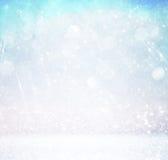 Blänka tappningljusbakgrund med ljusbristning silver, blått och vit de-fokuserat