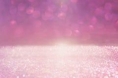 Blänka tappningljusbakgrund rosa färger och silver defocused fotografering för bildbyråer