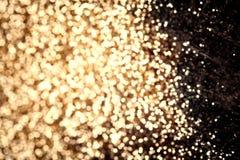 Blänker abstrakt bakgrund för guld- jul, det festliga kortet, guld Arkivfoto