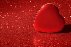 Blänker det nya året Valentine Day Red Heart Box för jul bakgrund Tyg för ferieabstrakt begrepptextur Beståndsdel exponering arkivbild