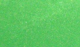 Blänker gräsplan för det nya året för jul bakgrund Tyg för ferieabstrakt begrepptextur Beståndsdel exponering royaltyfri foto