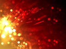 Blänker pråligt ljus för apelsinen, fyrverkerier, fyrverkerier på svart backg arkivbild