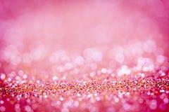 Blänker rosa bokehbelysning för abstrakt suddighet från textur Royaltyfri Fotografi