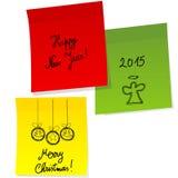 Blätter Papier mit Gekritzel Weihnachts- und guten Rutsch ins Neue Jahr-Mitteilung Lizenzfreie Stockfotos