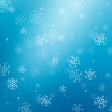 Blå abstrakt bakgrund med snöflingor Royaltyfri Foto