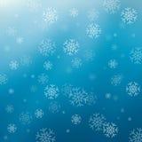 Blå abstrakt bakgrund med snöflingor Arkivbild