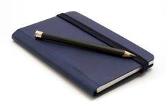 blå anteckningsbok arkivbild