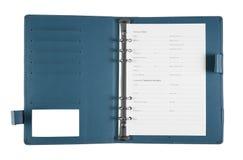 blå anteckningsbok med personliga data Arkivfoton