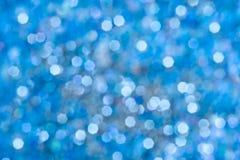 Blå bakgrund för bokehabstrakt begreppljus Royaltyfria Bilder