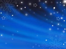 Blå bakgrund för jul med snowflakes Arkivbilder
