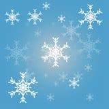 Blå bakgrund för julsnöflingor Royaltyfria Bilder