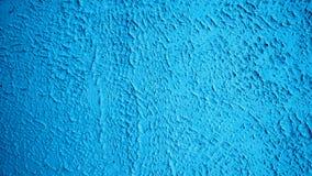 Blå bakgrund för stil för väggstuckaturtappning Målad yttersida, en gammal konkret byggnad i stad Texturerad beläggning av Royaltyfria Bilder
