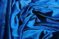 Blå bakgrund för tapet för siden- tyg för sammet Bakgrund för textur för closeup för räkning för abstrakt konst för sammetsilkebl Arkivbilder