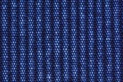 Blå bakgrund för textur för tyg för bomullsgrov bomullstvilljeans, slut upp Arkivbild