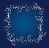 Blå bakgrund med den blom- ramen Royaltyfri Foto