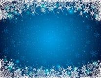 Blå bakgrund med ramen av snöflingor Arkivbilder