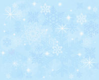 Blå bakgrund med snowflakes Arkivbilder