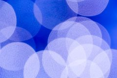Blå bokeh cirklar bakgrund Royaltyfria Bilder