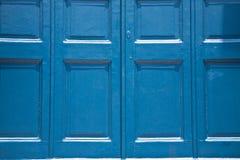 Blå dörrbakgrund Arkivbilder