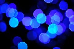 Blå defocuslampabakgrund Royaltyfria Foton