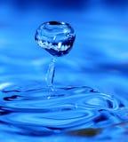 blå droppe Arkivfoto