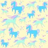 Blå enhörning på gul bakgrund med stjärnor Royaltyfri Foto